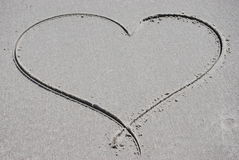 Heart drawn in the sand Stock Photo