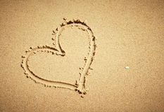 Heart drawn on sand. Royalty Free Stock Photo