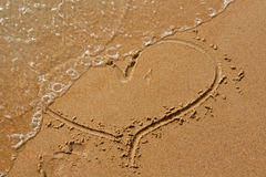 Heart drawn in the sand Royalty Free Stock Photography