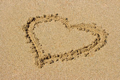 Heart drawn on sand Royalty Free Stock Photos