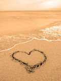 Heart drawn in sand Royalty Free Stock Image