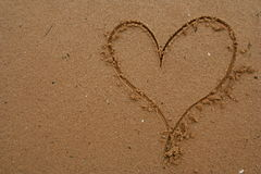 Heart drawn in sand. Heart symbol etched in sand Royalty Free Stock Images