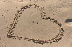 Heart drawn in sand Stock Images