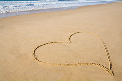 Heart drawn in sand Stock Image