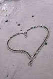 Heart drawn in the sand. Vertical of heart drawn in the sand Royalty Free Stock Images