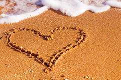 Heart drawn on sand Stock Images