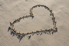 A heart drawn in the sand Royalty Free Stock Photography