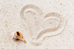 Heart drawn in the sand. Stock Images