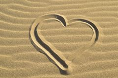 Heart drawn in the sand abstract background. Heart drawn in the sand, love,abstract background, summertime, holidays Royalty Free Stock Photo