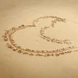 Heart drawn in sand. background. Stock Photos