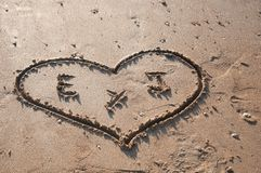 Heart drawn in the sand on the beach Royalty Free Stock Photo