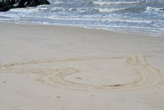 heart. A heart drawn in the sand at the beach Royalty Free Stock Images