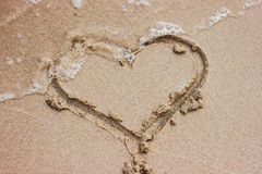 Heart drawn in the sand Stock Photography