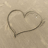 Heart drawn in the sand Stock Images