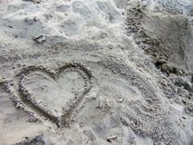 Heart drawn in the sand. At beach royalty free stock images