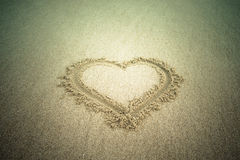Heart drawn in the sand. Beach background. Tinted Royalty Free Stock Image