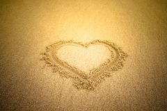 Heart drawn in the sand. Beach background. Tinted Stock Photography