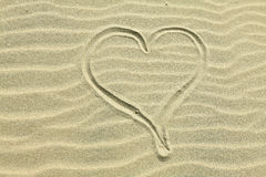 Heart drawn in the sand. Royalty Free Stock Photos