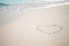 Heart drawn in the sand. Beach background. Top view Royalty Free Stock Photos
