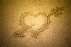 Heart drawn in the sand. Beach background. Top view. Tinted Royalty Free Stock Images