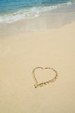 Heart Drawn in Sand on The Beach with Copy Space Stock Photos