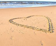 Heart drawn in a sand on a beach and sea Royalty Free Stock Photo