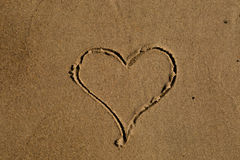 Heart drawn in sand Royalty Free Stock Photography
