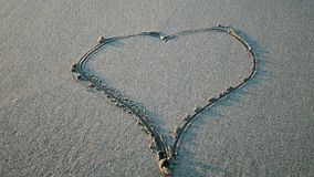 Heart drawn on the sand stock video