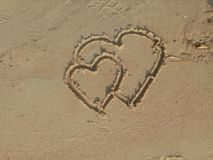 A heart drawn on sand. royalty free stock photography