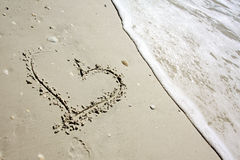 Heart Drawn in Sand by Ocean Stock Image