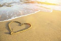Heart drawn on the sand of a sea beach. Royalty Free Stock Photos