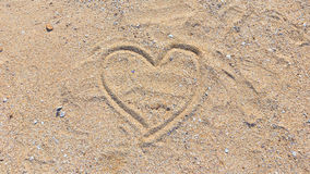 Heart drawn on sand stock photography