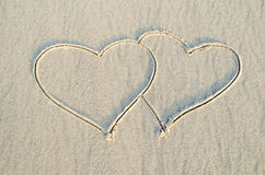 Heart drawn on sand. Sign of romantic and love Stock Photos