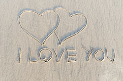 Heart drawn on sand Stock Image