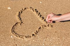 Heart drawn in the sand stick Royalty Free Stock Photography