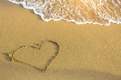Heart drawn in sea beach sand. Love. Royalty Free Stock Photos
