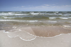 Heart drawn by sea foam on the beach sand Stock Photo