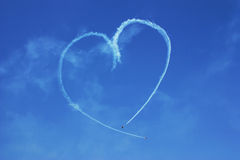 Heart drawn on the sky by airplanes Royalty Free Stock Image