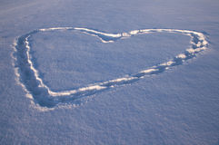 Heart drawn on a snow Stock Images