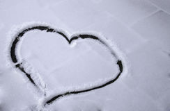 Heart drawn in snow Stock Images