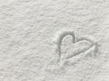 Heart drawn in the snow, background for valentines day royalty free stock photography