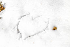 heart drawn in the snow Stock Photo