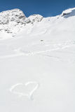 Heart drawn in the snow Royalty Free Stock Images