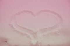 Heart drawn in the snow in a pink tinted Royalty Free Stock Photo