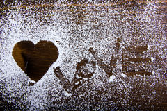 Heart drawn with sugar Royalty Free Stock Photography