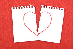Heart drawn on torn notebook page Stock Image