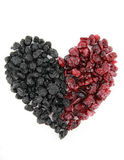Heart of dried blueberries and cranberries Royalty Free Stock Photography