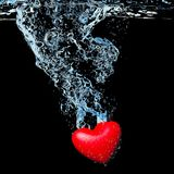 Heart dropped into water Royalty Free Stock Photo
