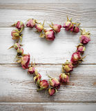 Heart from dry rose buds Royalty Free Stock Photo