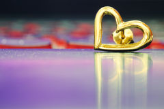 Heart earring on the floor with reflection.  royalty free stock photography